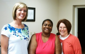 Mayda with Rachel Bricker, aquatic therapy aide, and Kate Albright, physical therapist, at DOAR Central in Danville, VA