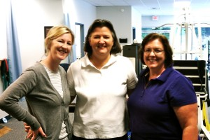 Amy Lynch, PT and Darlene Page with a physical therapy patient at TheraSport Physical Therapy in Summerfield, North Carolina