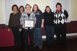 Kathy Adkins was recognized for 10 years of service to DOAR & Affiliates