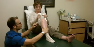 Michael Tamaddoni, DPT, Physical Therapist with a patient at Roxboro Physical Therapy