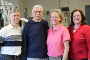Staff and Patient at TheraSport Physical Therapy in Summerfield, North Carolina